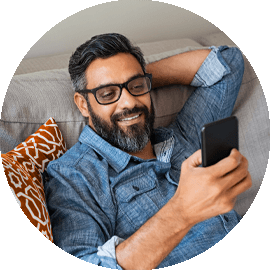 Man looking at phone on couch